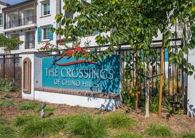 The Crossings of Chino Hills Sign with plants and tree