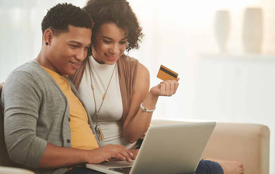 A couple paying online with credit card
